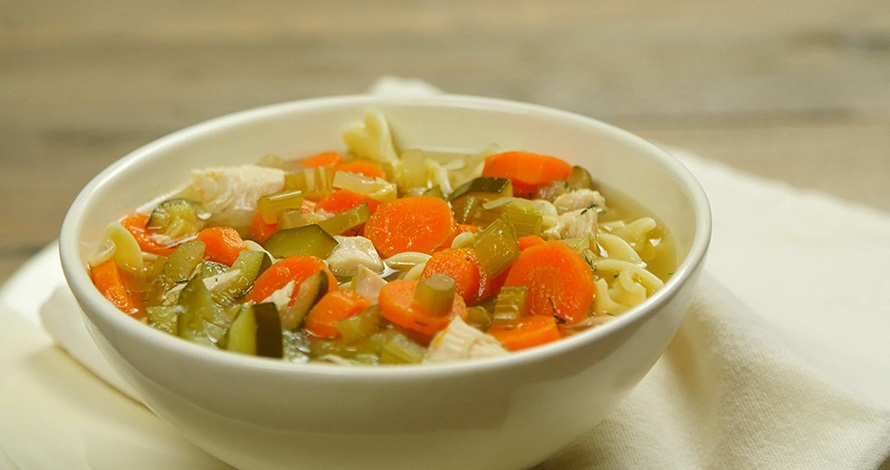 bowl of chunky chicken noodle soup with carrots, celery, onions, cucumbers from american heart association heart-health recipes